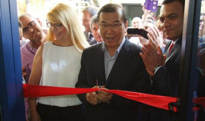 DXN Spain office opening with dr. Lim cutting the red ribbon