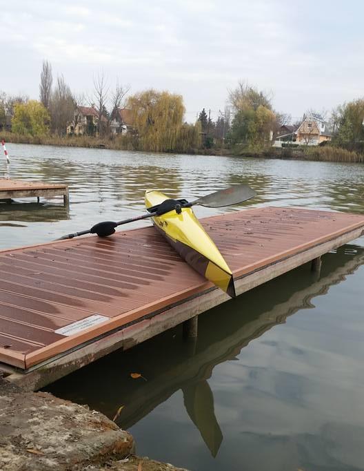Yellow K1 kayak on pier at Csepel Island, Budapest, Hungary